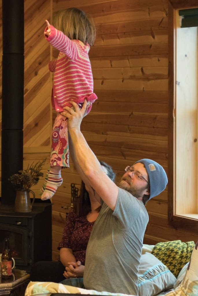 Jim lifting up his youngest daughter