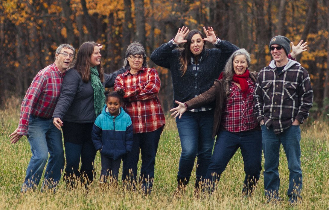 A bunch of Maple Valley Cooperative employees being silly in a field in fall of 2017.