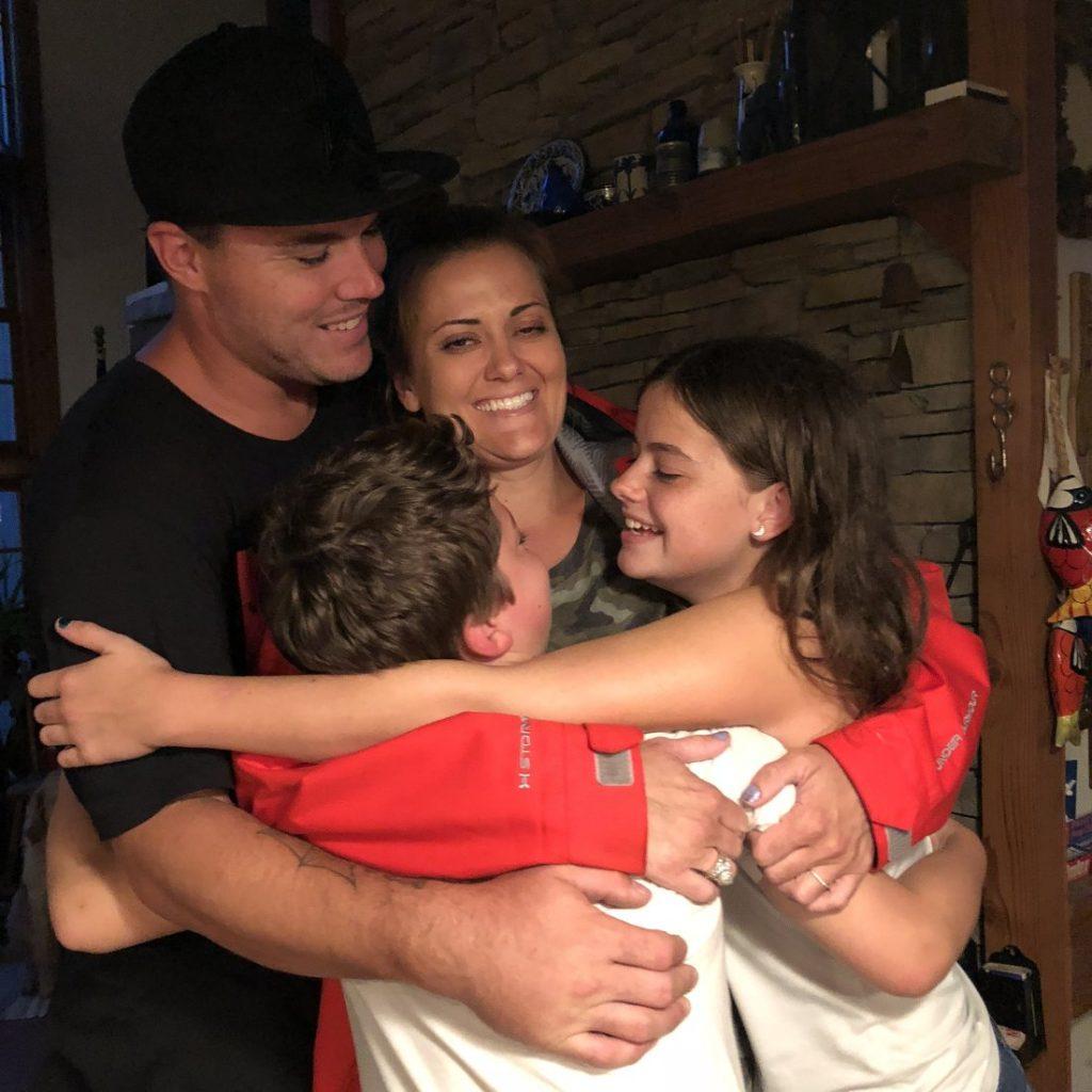 Nicole & family group hug.