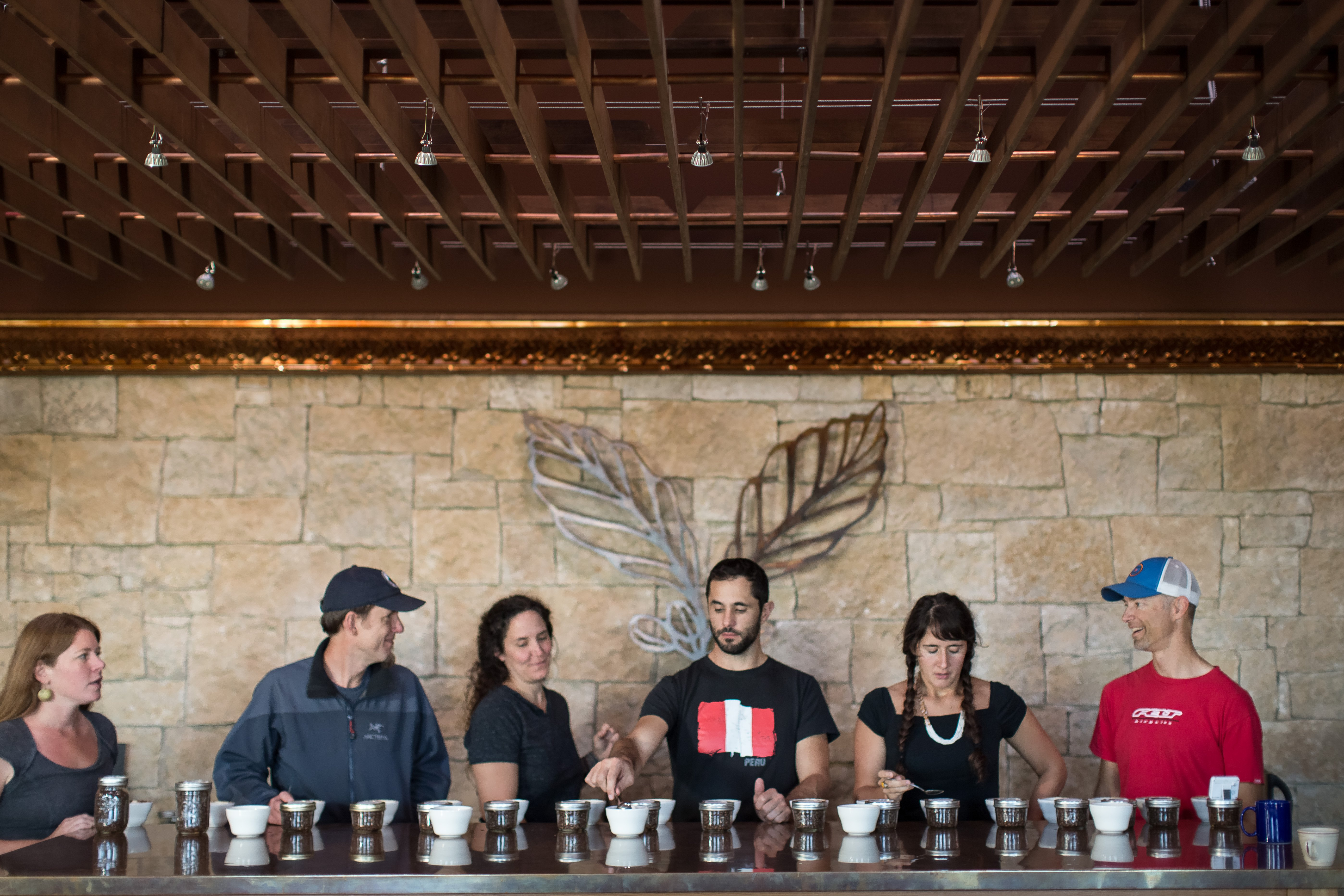 Our team tastes through coffees in the cupping lab.